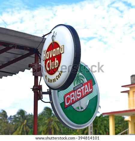 VARADERO, CUBA, - JANUARY 18, 2016:  Signs on a bar in Varadero for Havana Club, a popular rum, and Cristal a popular beer in Cuba. - stock photo