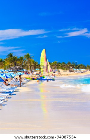 VARADERO,CUBA-JANUARY 28:Tourists enjoying the beach January 28,2012 in Varadero.One of the largest resort areas in the Caribbean, Varadero receives more than 3.5 million visitors per year - stock photo
