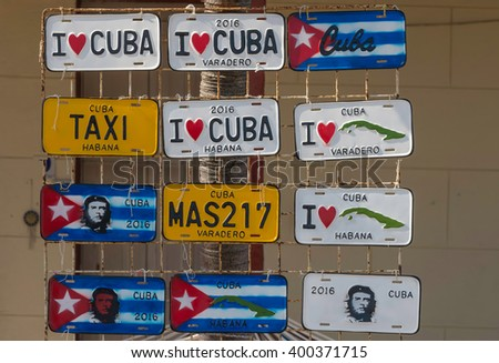 Varadero, Cuba - March 6, 2016: Decorative touristy license plates with Cuban motifs shown on a display rack in Varadero, Cuba. - stock photo