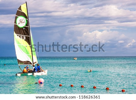 VARADERO,CUBA-NOVEMBER 3:Family of tourists sailing November 3,2012 in Varadero.With over a million visitors per year,Varadero is the main destination for the growing cuban tourism industry - stock photo
