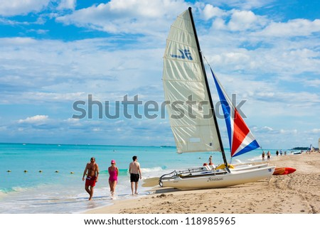 VARADERO,CUBA-NOVEMBER 3:Tourists enjoying the beach November 3,2012 in Varadero.With over a million foreign visitors per year,Varadero is the destination of more than 40% of people visiting Cuba - stock photo