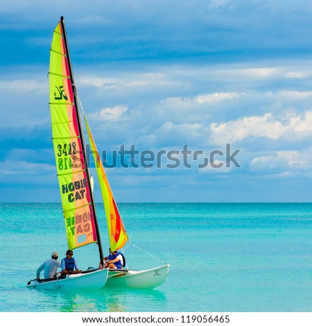 VARADERO,CUBA-NOVEMBER 3:Young couple sailing on a catamaran November 3,2012 in Varadero.With over a million visitors per year,Varadero is the destination of 40% of tourists visiting the island - stock photo