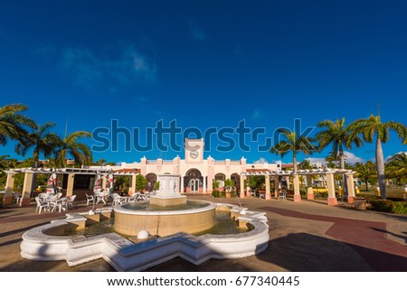 VARADERO, MATANZAS, CUBA - MAY 18, 2017: View of the fountain and the building. Copy space for text. Isolated on blue background