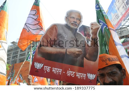 VARANASI-APRIL 24: A person poses with a Narendra Modi  cut out  during a rally in his support  on April  24, 2014 in Varanasi , India. - stock photo
