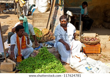 VARANASI - APRIL 23: Market vendors selling vegetables on a market on April 23, 2011 in Varanasi, India. India ranks second worldwide in farm output. Agriculture employs 52.1% of the total workforce