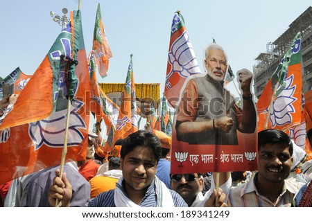 VARANASI-APRIL 24: Supporters of  Narendra Modi  participating  rally in his support  on April  24, 2014 in Varanasi , India. - stock photo