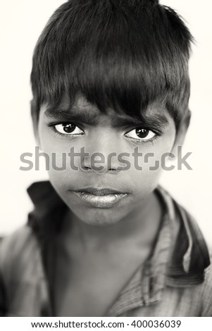 VARANASI - INDIA - DECEMBER 28, 2015: Unidentified young gypsy boy on December 28, 2015 in Varanasi, India. Varanasi is the holiest of the seven sacred cities in India. - stock photo