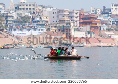 VARANASI, INDIA - FEB 19 - Pilgrims rowing a boat along the ghats of Varanasi in North India on February 19th 2013