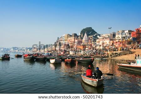 VARANASI, INDIA - 14 FEBRUARY:  Main ghat on the banks of Ganges river,  in holy Varanasi,  Uttar Pradesh, on  February 14, 2008 in Varanasi, India. - stock photo