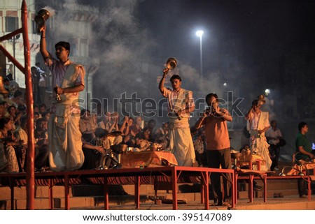 VARANASI, INDIA- MAR 03:Hindu priests perform the Ganga Aarti ritual on March 03, 2016 at Assi Ghat on the banks of the river Ganges in Varanasi, India. - stock photo