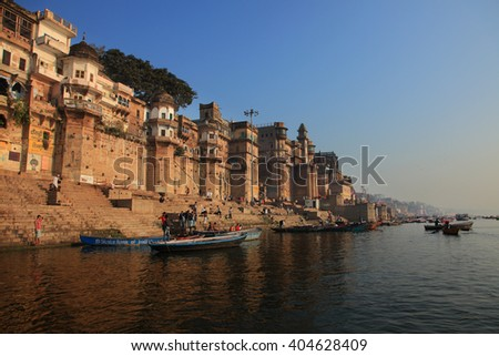 VARANASI, INDIA- MAR 07:Unidentified Hindu pilgrims take bath in the Holy river Ganges on the auspicious Maha Shivaratri festival on March 07, 2016 at the ghats of Varanasi, Uttar Pradesh, India. - stock photo