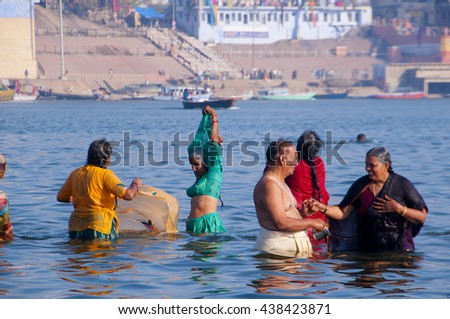 VARANASI, INDIA- MAR 09:Unidentified Hindu pilgrims take bath in the Holy river Ganges on the auspicious Maha Shivaratri festival on March 09, 2013 at the ghats of Varanasi, Uttar Pradesh, India. - stock photo