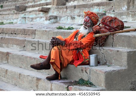 VARANASI, INDIA- MAR 03:Unidentified Hindu saint relaxes in the ghats of the river Ganges on March 03, 2016 in Varanasi, Uttar Pradesh, India.Varanasi is the most popular Hindu pilgrim place in India. - stock photo