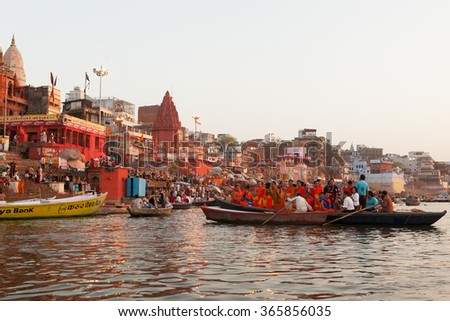 Varanasi, India-March 19,2013 :Hinduism and Buddhism have similarities in the Ganges culture, these unidentified hindu and buddhist people live, pray and share together around the temples of Varanasi  - stock photo