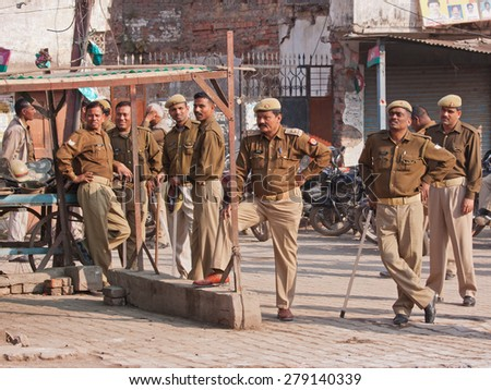 VARANASI, INDIA - MARCH 4, 2015: Local police assembled to provide security cover on the occasion of a visit to the city by the Chief Minister of the Indian government - stock photo