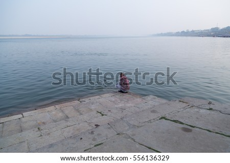 Varanasi , India -13 May 2015: Scene from the bank of River Ganges. With soft and misty background