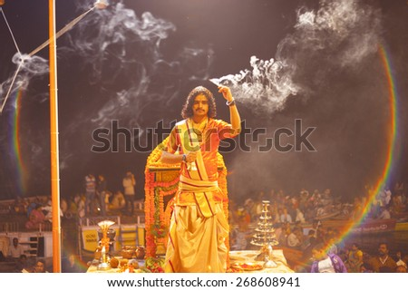 VARANASI, INDIA - November 25: An unidentified Hindu priest performs religious Ganga Aarti ritual (fire puja) at Dashashwamedh Ghat on November 25, 2012 in Varanasi, Uttar Pradesh, Central India  - stock photo