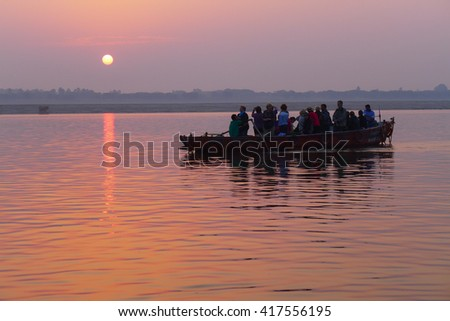Varanasi,INDIA-November 2014:Tourists are sailing and watching the sun rise on gan-ga river-November 9, 2014 at gan-ga river in Varanasi,the people in India believe that the Ganges is a holy river.