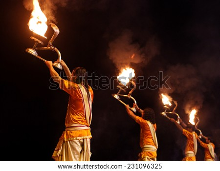 VARANASI, INDIA-02 OCT:A Hindu priest performs the Ganga Aarti ritual on 02 Oct, 2014 in Varanasi.Fire puja is a Hindu ritual that takes place at Dashashwamedh Ghat on the banks of the river Ganges - stock photo