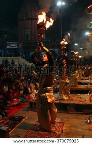 VARANASI - JAN 15: A group of Hindu priests performs religious Ganga Aarti ritual (worship with fire) at Dashashwamedh Ghat in Varanasi on January 15. 2016 in India