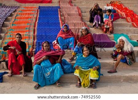 VARANASI - JANUARY 15: Unidentified hindu pilgrims dry their saris after bathing in the sacred Ganges river at Dashashwamedh ghat on January 15, 2010 in Varanasi, State of Uttar Pradesh, India - stock photo