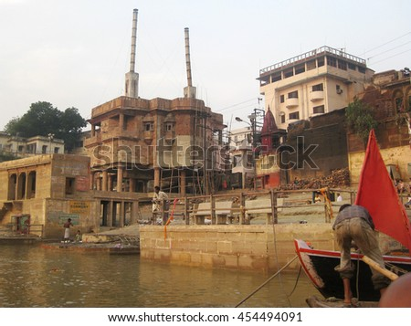 Varanasi, Uttar Pradesh, India - October 2011: View of the Ganges River banks with devotees and visitors. - stock photo