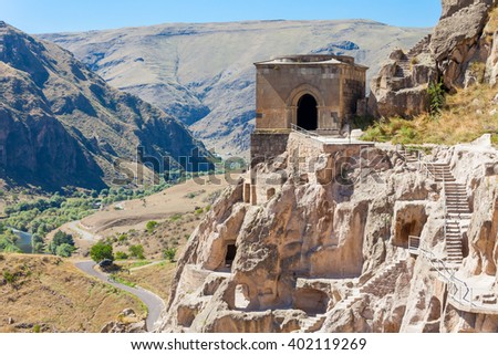 Vardzia is a cave monastery site excavated from Erusheti Mountain on the left bank of the Mtkvari River, near Akhaltsikhe, Georgia. - stock photo