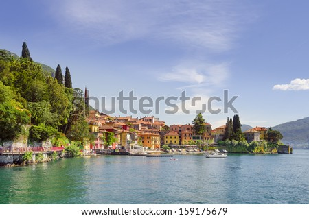 Varenna in afternoon sunlight seen from the lake, Lake Como, Italy - stock photo