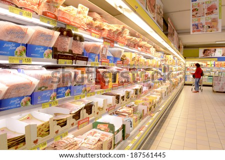 VARESE, ITALY-APRIL 11, 2014: Packaged food in a supermarket aisle, in Varese.