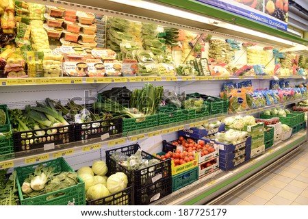 VARESE, ITALY-APRIL 11, 2014: Vegetables and packaged food in a supermarket shelve, in Varese.