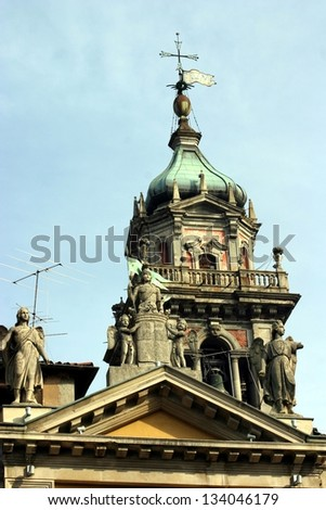 Varese, Italy, statues over roof of Arco Mera Palace, and cathedral Bell Tower behind, particular