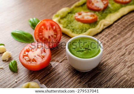 Variantion of pizza - with herbs pesto and tomatoes, calsone pizza and pizza rolls - stock photo