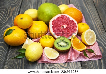 Variation of Citrus Fruits with leaves on table