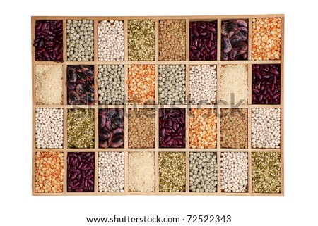 Variation of different beans, lentils and peas in wooden box. Leguminous collection. - stock photo