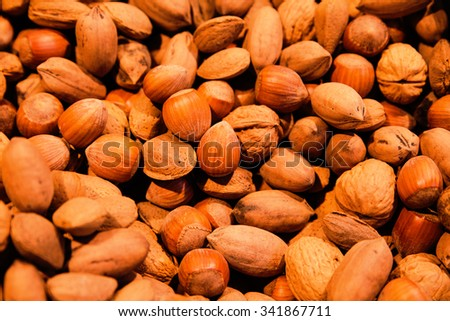 variation of different nuts on market - stock photo