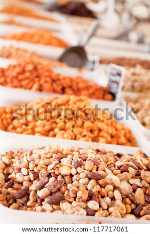 variation of different nuts on market outdoor in summer - stock photo
