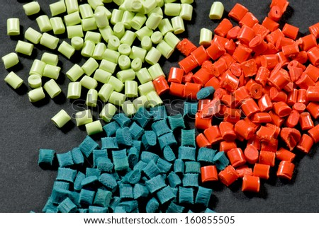 variation of dyed polymer resins for injection moulding - stock photo