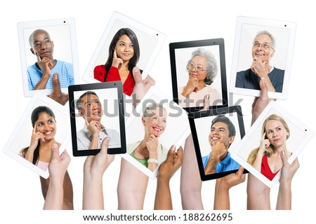 Variation of hands holding digital tablets with multi ethnic people thinking of inspiration. - stock photo