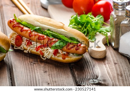 Variation on the red hot dogs, onion tomato, arugula and chilli peppers with chinese noodles - stock photo
