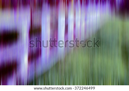 Varicolored abstract of receding paddock fence with vertical motion blur, for background or illustration with motifs of ambiguity, sequence, repetition - stock photo