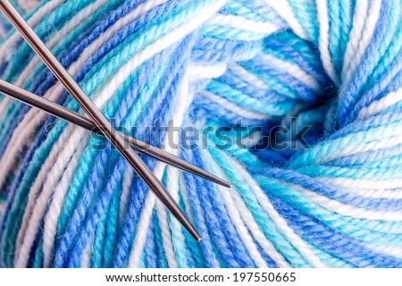 Varicolored balloon of yarn with metal knitting needles - stock photo