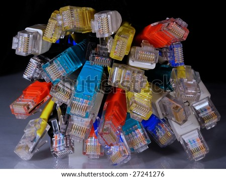 Varicolored network connectors rj45 on black background - stock photo