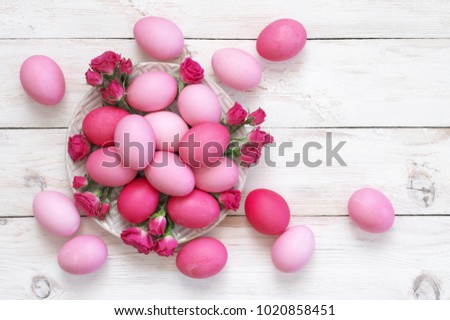 Varicolored Pink Easter Eggs In Plate With Roses Decor On Rustic White  Wooden Table. Top