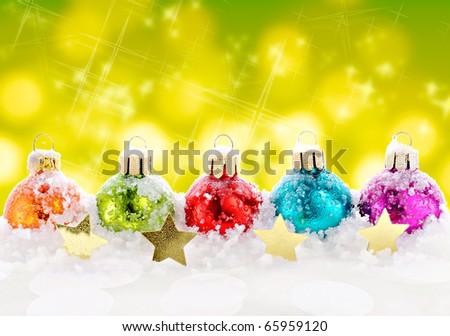 Varicoloured christmas balls on colorful light background - stock photo