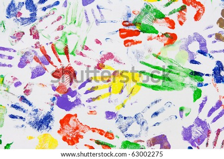 Varicoloured imprint of the hands on white canvas - stock photo