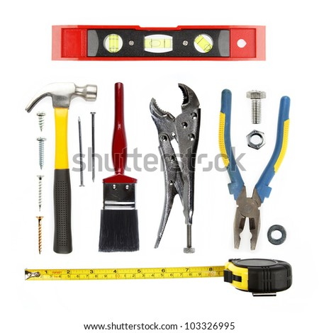Varied tools on plain background - stock photo