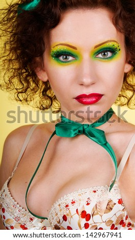 Variegated make-up girl looking intently