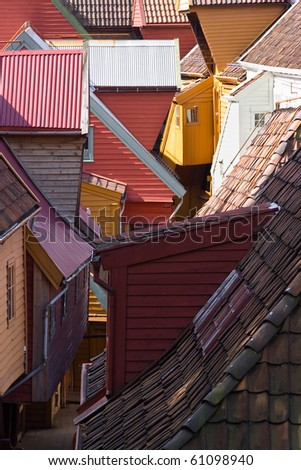 variegated wood houses of old town - stock photo
