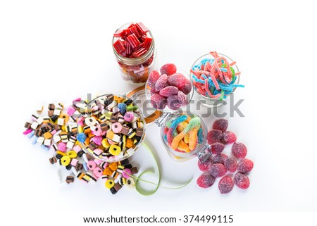 Variery of colorful candies on a white background.