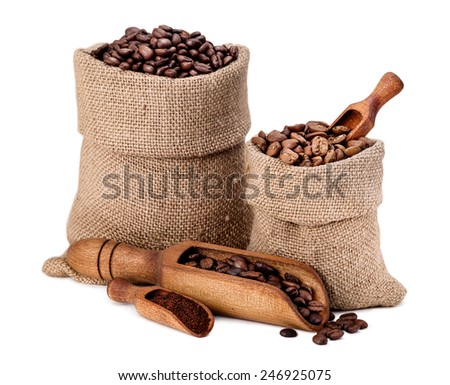 Varieties of coffee beans in a canvas bag isolated white background - stock photo